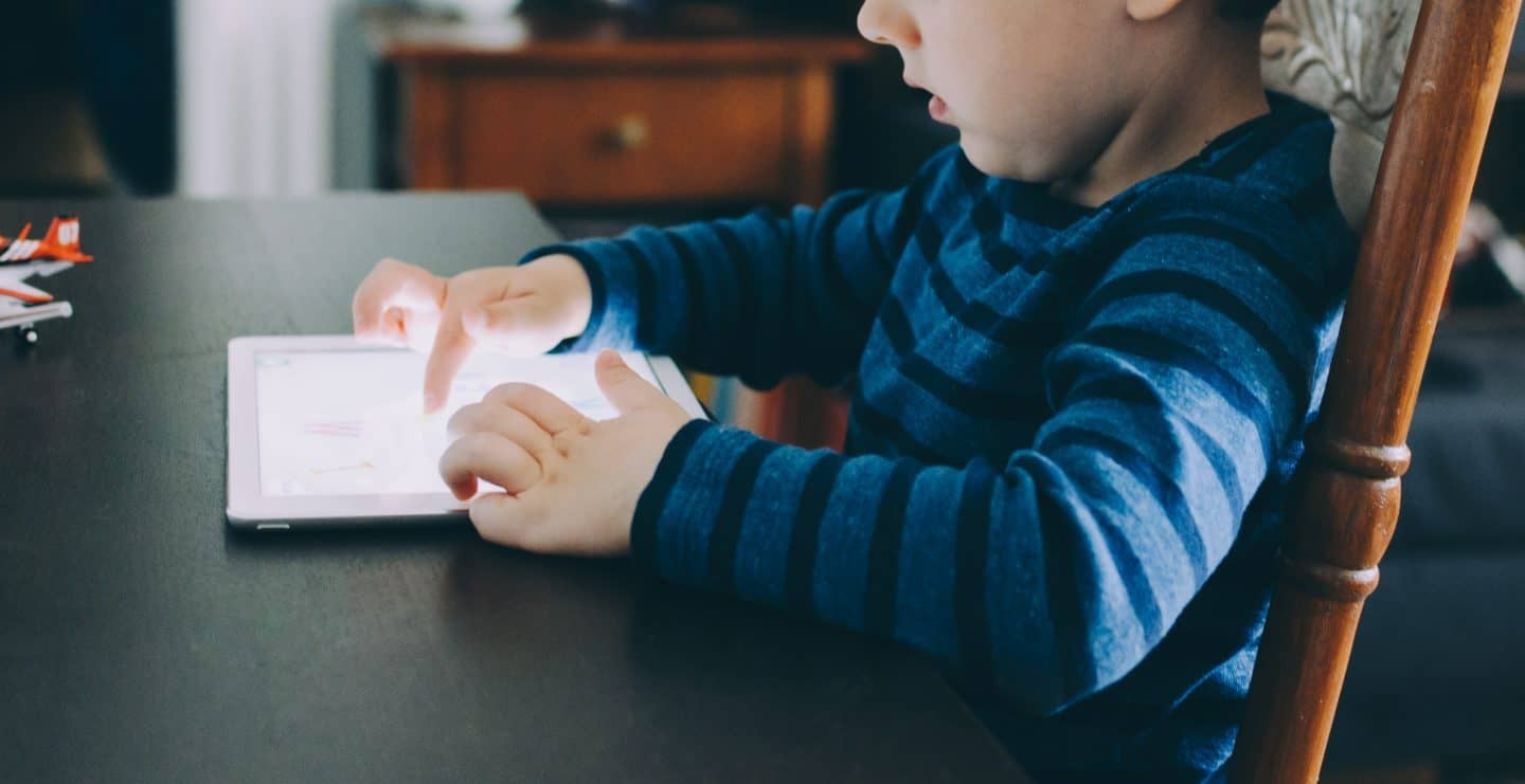 boy learning time management sills for kids from an app